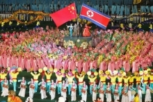 Crowd waving North Korea and China flags